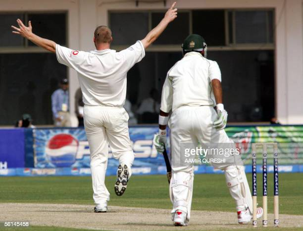 England's bowler Andrew Flintoff succesfully appeals for a Leg Before Wicket decision against Pakistani batsman Shoaib Malik during the opening day...