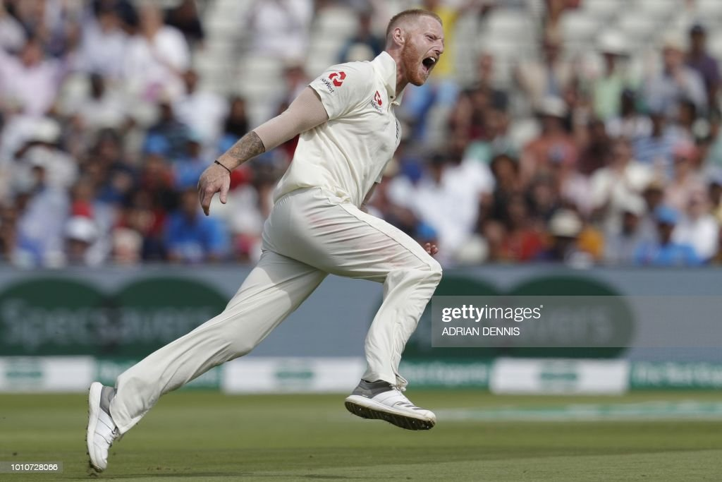 TOPSHOT - England's bowler Ben Stokes celebrates taking the wicket of India's Mohammed Shami during play on the fourth day of the first Test cricket match between England and India at Edgbaston in Birmingham, central England on August 4, 2018.