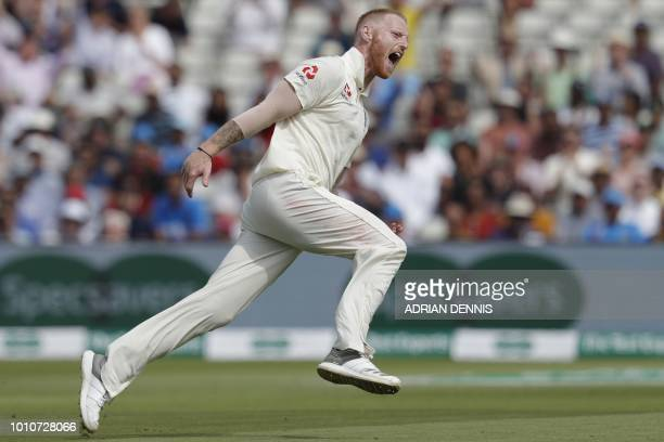 TOPSHOT England's bowler Ben Stokes celebrates taking the wicket of India's Mohammed Shami during play on the fourth day of the first Test cricket...