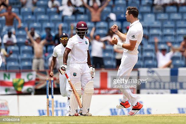 England's bowler James Anderson celebrates bowling out West Indies batsman Devon Smith during day four of the second Test cricket match between the...
