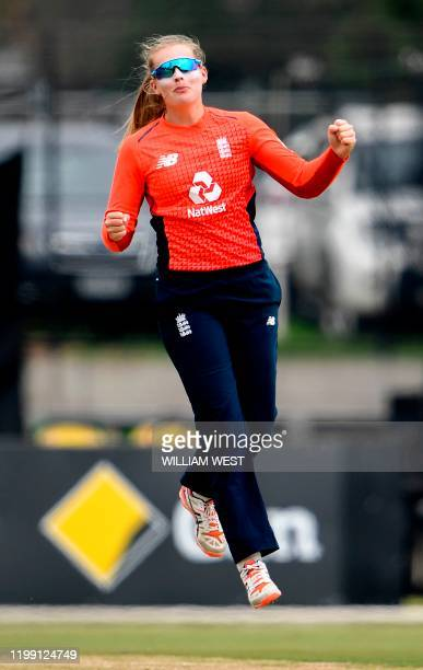 England's bowler Sophie Ecclestone celebrates her dismissal of India's Shafali Verma during their women's T20 international cricket match in...