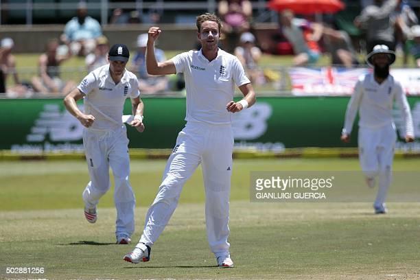 England's bowler Stuart Broad celebrates after dismissing South African batsman Morne Morkel during the day five of the first Test match between...