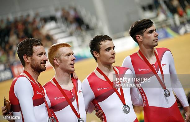 England's Bradley Wiggins Ed Clancy Steven Burke and Andy Tennant pose on the podium after winning the silver medal in the men's 4000m team pursuit...