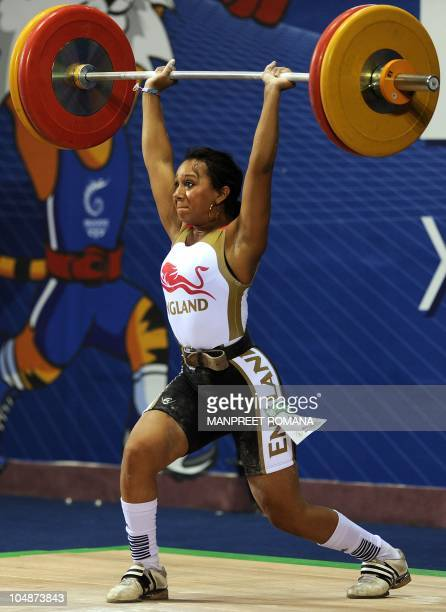 England's bronze medal winner Zoe Smith attempts a lift in the women's 58 kg weightlifting clean and jerk event during the Commonwealth Games at...