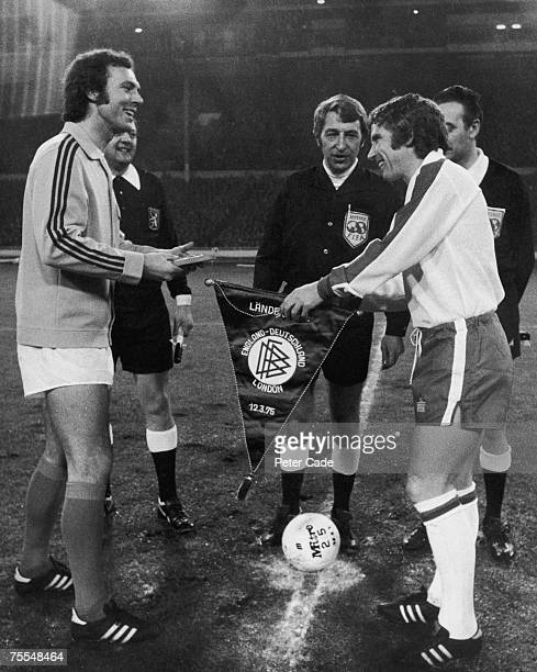 England's captain Alan Ball right exchanging pennants with Franz Beckenbauer his West German equivalent before an international friendly at Wembley...