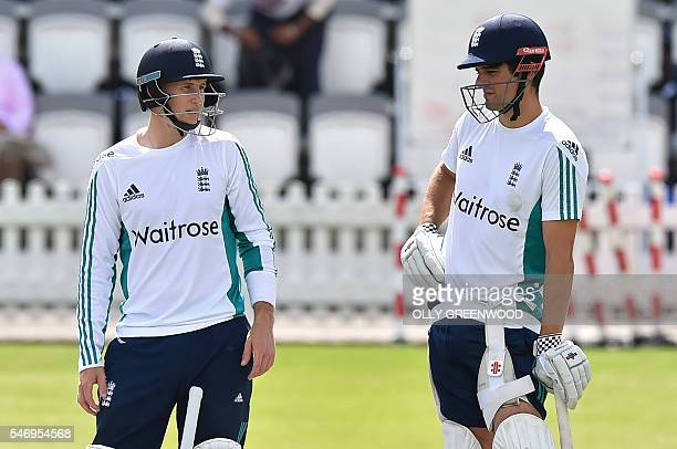 England's captain Alastair Cook and England's Joe Root chat during a practice session at Lord's cricket ground in London on July 13 2016 England play...