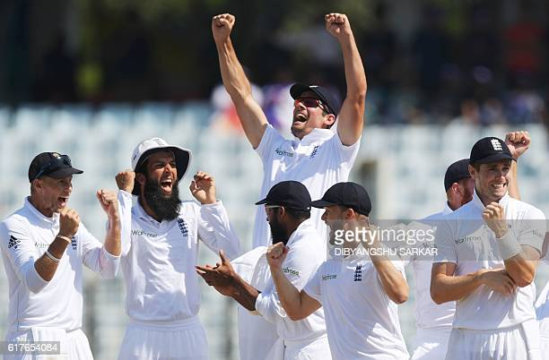 England's captain Alastair Cook celebrates with teammates after beating Bangladesh during the final day's play of the first Test cricket match at...