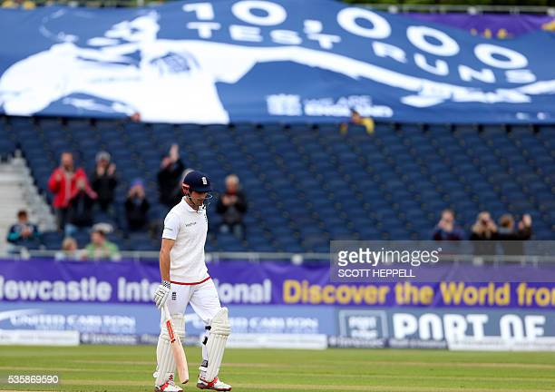 England's captain Alastair Cook is pictured after scoring 10000 test match runs during play on the fourth day of the second test cricket match...