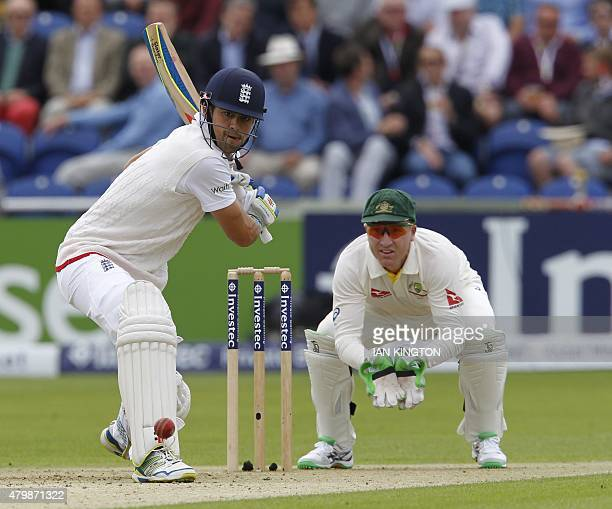England's captain Alastair Cook prepares to hit a shot watched by Australias wicketkeeper Brad Haddin during play on the first day of the opening...