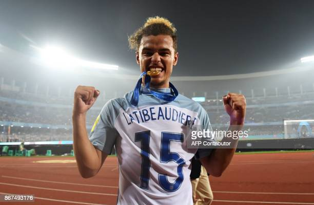 England's captain and defender Joel Latibeaudiere celebrates after England's win over Spain in the final FIFA U17 World Cup football match at the...
