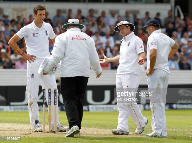 England's Captain Andrew Strauss gestures to Umpire Steve Davis after he calls a dead ball as England appeal for the wicket of South African Captain...