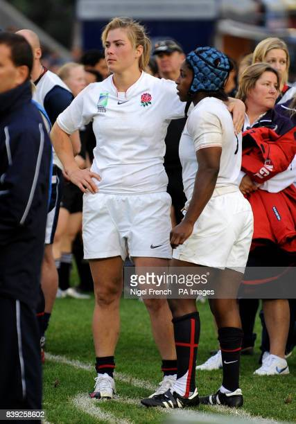 England's Captain Catherine Spencer consoles with team mate Maggie Alphonsi after defeat to New Zealand during the Final at Twickenham Stoop London