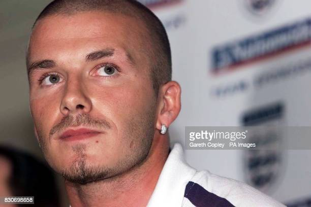 England's captain David Beckham laughs during a press conference at the Mandarin Oriental Hotel in Munich, Germany. England are to play Germany in...