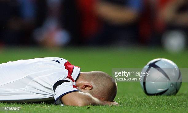 England's captain David Beckham lies on the ground 24 June 2004 at the Estadio da Luz in Lisbon during their European Nations championship...