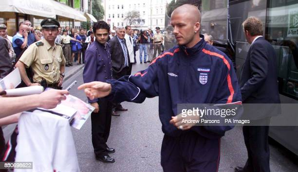 England's captain David Beckham signs autographs as the England football team arrive at the Mandarin Oriental Hotel in Munich, Germany. England are...
