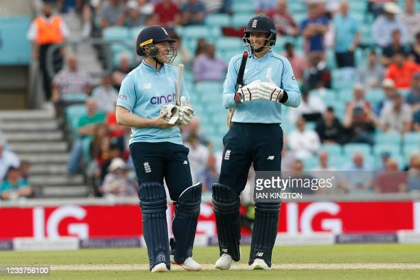 England's Captain Eoin Morgan and England's Joe Root chat during the second one-day international between England and Sri Lanka at The Oval, south...