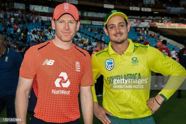 England's captain Eoin Morgan and South Africa's Quinton de Kock pose after the third T20 International cricket match between South Africa and...