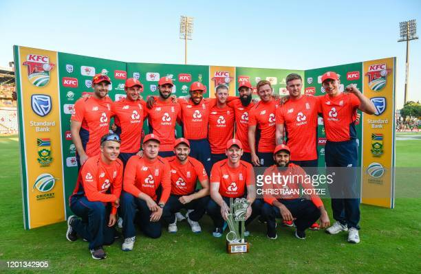 England's captain Eoin Morgan and teammates pose with the Series Winners trophy after the third T20 International cricket match between South Africa...