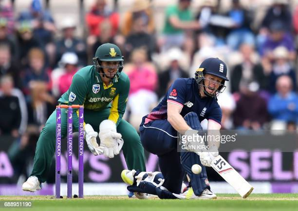 England's captain Eoin Morgan bats as South Africa's wicketkeeper Quinton de Kock looks onduring the second OneDay International between England and...