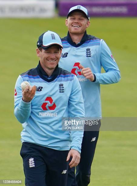 England's Captain Eoin Morgan celebrates catching the shot of Australia's Pat Cummins who is dismissed for nine runs during the one-day international...