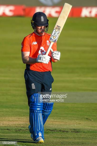 England's captain Eoin Morgan celebrats after getting his fifty run during the third T20 International cricket match between South Africa and England...