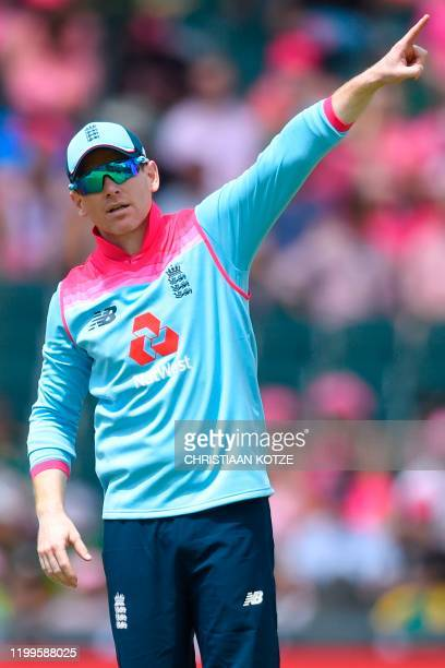 England's captain Eoin Morgan gestures as he sets the field during the third one day international cricket match between South Africa and England at...