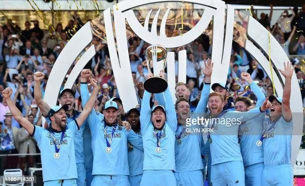 England's captain Eoin Morgan lifts the World Cup trophy as England's players celebrate their win after the 2019 Cricket World Cup final between...