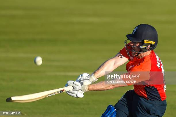 TOPSHOT England's captain Eoin Morgan plays a shot during the third T20 International cricket match between South Africa and England at the...
