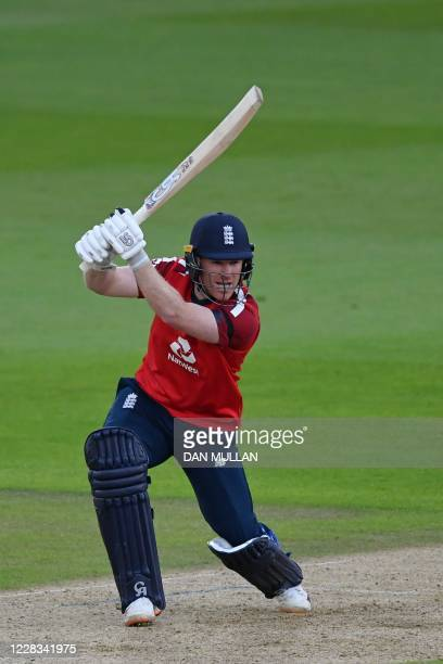 England's Captain Eoin Morgan plays a shot to hit the ball for four runs during the international Twenty20 cricket match between England and...