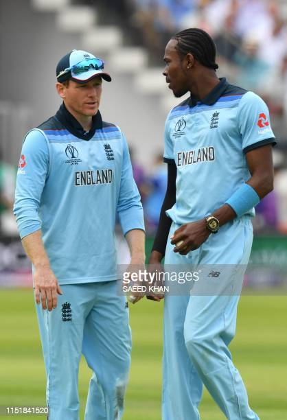 England's captain Eoin Morgan speaks with teammate Jofra Archer during the 2019 Cricket World Cup group stage match between England and Australia at...