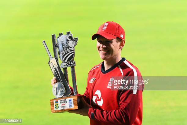 England's captain Eoin Morgan stands holds the trophy after England won the T20 international cricket series between South Africa and England at...