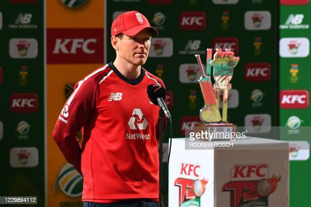 England's captain Eoin Morgan stands next to the trophy after England won the T20 international cricket series between South Africa and England at...