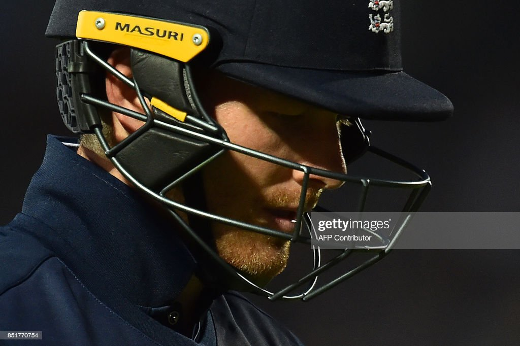 England's captain Eoin Morgan walks back to the pavilion after losing his wicket for 19 runs during the fourth One-Day International (ODI) cricket match between England and the West Indies at the Oval in London on September 27, 2017. / AFP PHOTO / Glyn KIRK / RESTRICTED