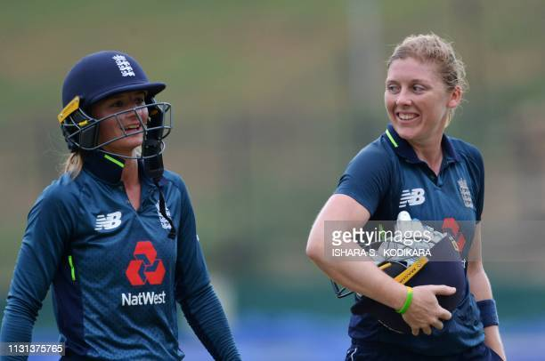 England's captain Heather Knight and Danielle Wyatt leave the field after England's victory by 6 wickets during the second one day international...