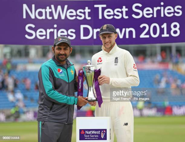 England's captain Joe Root alongside Pakistan's captain Sarfraz Ahmed after the drawn NatWest Test series during day three of the Second NatWest Test...
