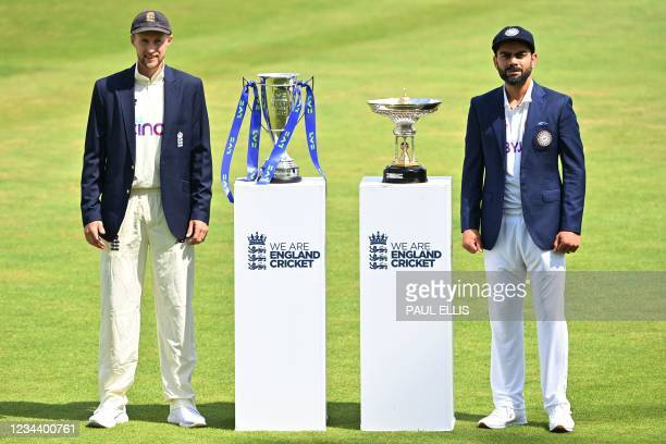 England's captain Joe Root and India's captain Virat Kohli pose with the Pataudi Trophy and the Test series trophy at Trent Bridge Cricket Ground in...