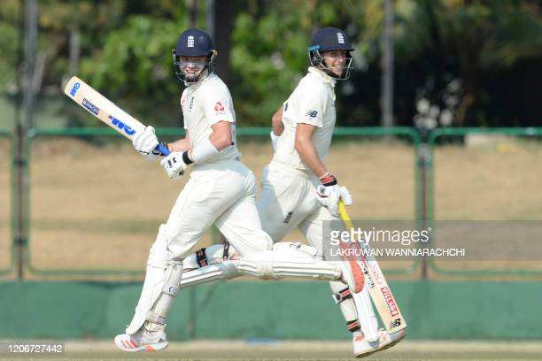 England's captain Joe Root and Ollie Pope run between the wickets during the opening day of a fourday practice match between Sri Lanka Board...
