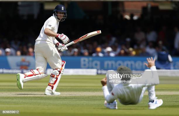 England's captain Joe Root avoids being caught out by South Africa's Jean-Paul Duminy during the first day of the first Test match between England...