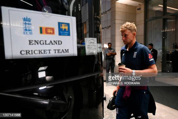 England's captain Joe Root boards a bus for the airport in Colombo on March 14, 2020. - England's cricket team abruptly pulled out of a tour of Sri...