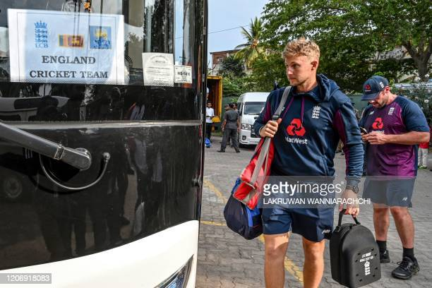 England's captain Joe Root boards the bus after the Test series against Sri Lanka was postponed at the P Sara Oval Cricket Stadium in Colombo on...