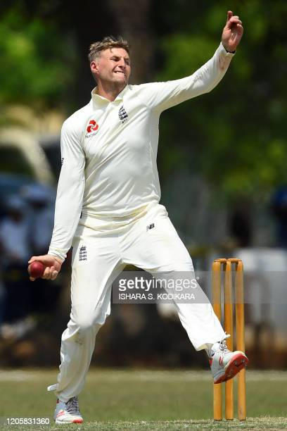 England's captain Joe Root bowls during the second day of a three-day practice match between Sri Lanka Cricket XI and England at the Marians Cricket...