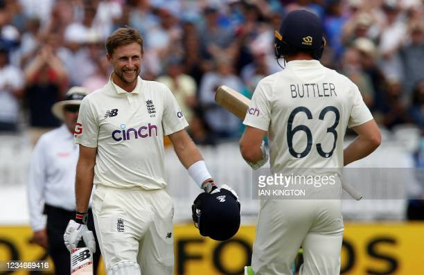 England's captain Joe Root celebrates his century with England's Jos Buttler on the third day of the second cricket Test match between England and...