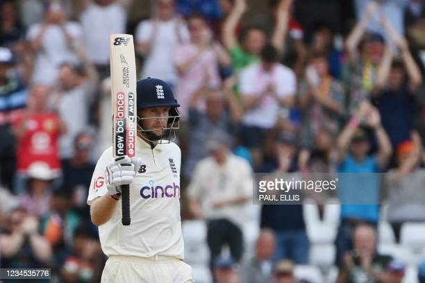 England's captain Joe Root celebrates his half-century on the fourth day of the first cricket Test match of the India Tour of England 2021 between...