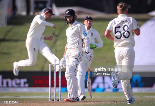 England's captain Joe Root celebrates with team mates after dismissing New Zealand's captain Kane Williamson during the second day of the first Test...