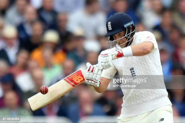 England's captain Joe Root hits a boundary during the second day of the second Test match between England and South Africa at Trent Bridge cricket...