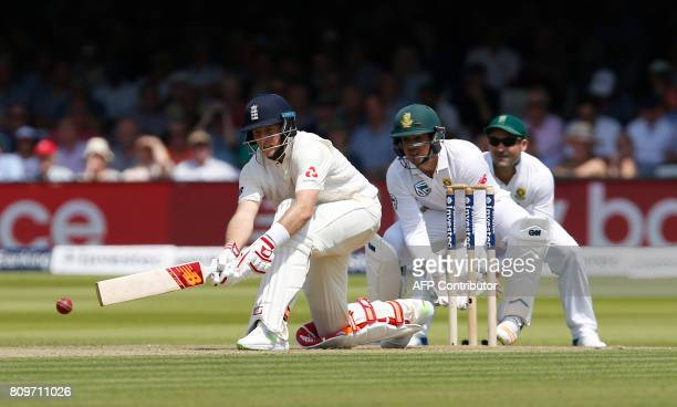 England's Captain Joe Root hits a reverse sweep shot watched by South Africa's wicketkeeper Quinton de Kock on the first day of the first Test match...