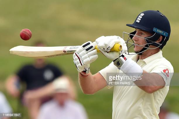 England's captain Joe Root hits the ball for four runs on day four of the second cricket Test match between England and New Zealand at Seddon Park in...