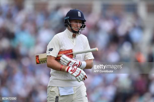 England's captain Joe Root leaves the field after getting caught out off the bowling of South Africa's Vernon Philander for 29 runs on the first day...