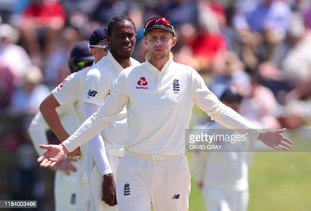England's captain Joe Root reacts towards the umpire after appealing for LBW for New Zealand's Henry Nicholls during the third day of the first...