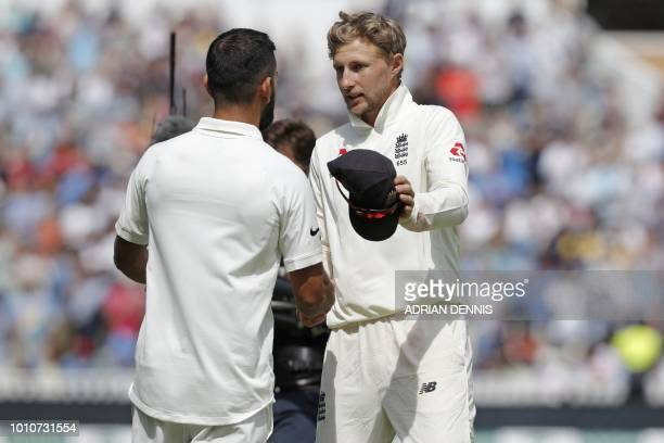 England's captain Joe Root shakes hands with India's captain Virat Kohli after the game ends on the fourth day of the first Test cricket match...